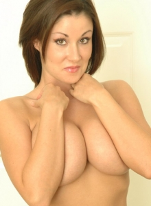 The Very Busty Brunette Sweet Krissy Unzips Her Black Leather Top Exposing Her Huge Tits - Picture 11