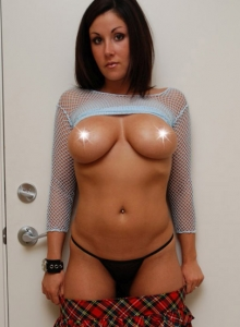 Krissy shows off her huge tits in a fishnet top from Sweet Krissy